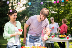 Couple at barbecue party Royalty Free Stock Image