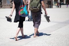 Couple barefoot in the city Royalty Free Stock Image