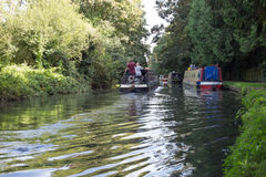 Couple on a barge travelling down the grand union canal Royalty Free Stock Image