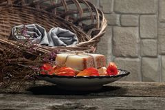 Couple bars of handmade soap on oriental plate with several fruits of physalis royalty free stock images