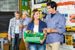 Couple With Basket Buying Tools At Hardware Store Royalty Free Stock Photo