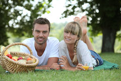 Couple with a basket Royalty Free Stock Image