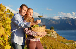 A couple with a basket full of grapes. Switzerland Royalty Free Stock Photo