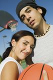 Couple at Basketball Court. Royalty Free Stock Images