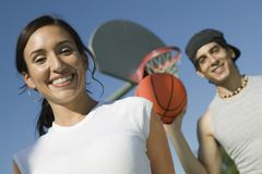 Couple at Basketball Court low angle view. Stock Images