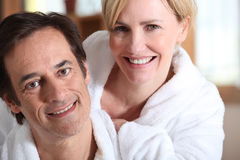 Couple in bath robes. Couple in matching bath robes Stock Image