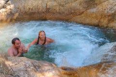 Couple bathed in stone tub mountain creek in Canyon Kuzdere. Stock Photos