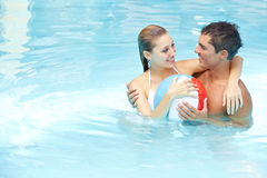 Couple bathing with beach ball Stock Images