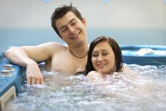 Couple bathing at jacuzzi Royalty Free Stock Photography