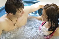 Couple bathing at jacuzzi Stock Image