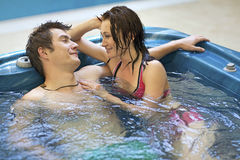 Couple bathing at jacuzzi Stock Photos