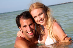 Couple bathing in the sea Stock Images