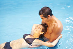 Couple bathing together in swimming Stock Image