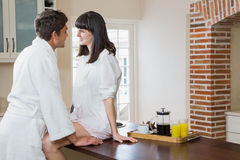 Couple in bathrobe in kitchen Royalty Free Stock Photos