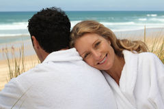 Couple in bathrobes Stock Image