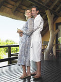 Couple In Bathrobes Embracing Stock Photography
