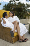 Couple In Bathrobes Embracing Outdoors Stock Images
