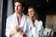 Couple in bathrobes enjoying wellness weekend in hotel royalty free stock photography