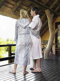 Couple In Bathrobes Looking At View Royalty Free Stock Photography