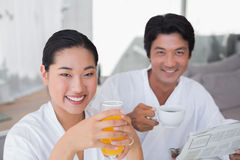 Couple in bathrobes spending the morning together Royalty Free Stock Photo