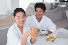 Couple in bathrobes spending the morning together Royalty Free Stock Image