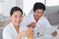 Couple in bathrobes spending the morning together Royalty Free Stock Photos