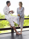 Couple In Bathrobes With Tea Royalty Free Stock Photo