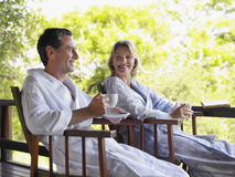 Couple In Bathrobes At Terrace Stock Image