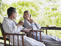 Couple In Bathrobes At Terrace Stock Images