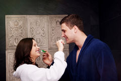 Couple in the bathroom brushing teeth. Stock Photos
