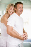 Couple in bathroom embracing. And smiling royalty free stock images