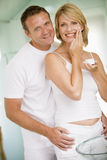 Couple in bathroom with face cream Royalty Free Stock Photo