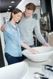 Couple in bathroom fixture shop. Couple in the bathroom fixture shop Stock Photography
