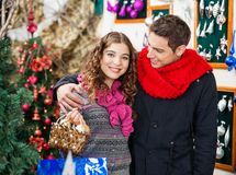 Couple With Bauble Basket In Store Royalty Free Stock Photo