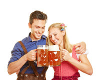 Couple in Bavaria clinking beer Royalty Free Stock Images