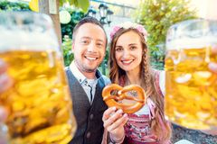 Couple in Bavaria enjoying a beer in a traditional pub royalty free stock images