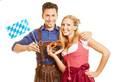 Couple in bavaria with pretzel Stock Images