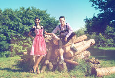 Couple in Bavarian clothes posing in countryside Royalty Free Stock Photo