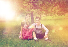 Couple in Bavarian clothes posing together outside Royalty Free Stock Photography