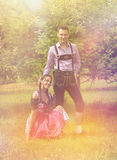 Couple in Bavarian clothes posing together outside Royalty Free Stock Photos