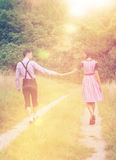 Couple in Bavarian clothes walk together outdoors Stock Photography