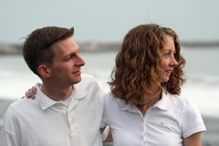 Couple at the Beach. A young couple ponder their future at the beach Stock Photo
