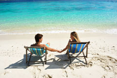 Couple on a beach Stock Images
