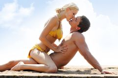 Couple  on the beach. Young beautiful couple are kissing on the beach Stock Image