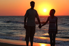 Couple on the beach Stock Photos