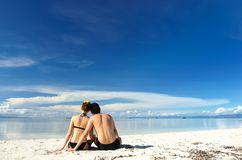 Couple on a beach Royalty Free Stock Photos
