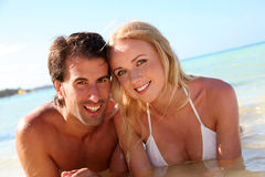 Couple at the beach. Just married couple bathing in crystal clear water Stock Images