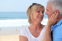 Couple at the beach Stock Images