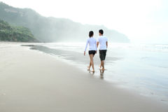 Couple in the beach Stock Photos