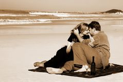 Couple on the beach. In love enjoying wine stock photography